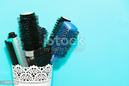 1169941952 istock photo many different combs in the stand, Barber concept. 1164977253