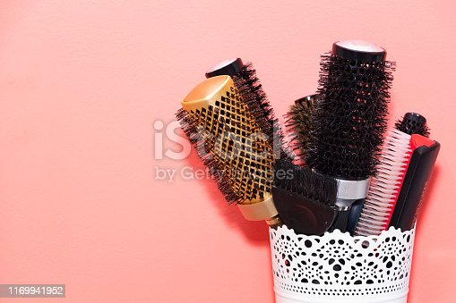 1169941952 istock photo many different combs in the stand, Barber concept. 1169941952