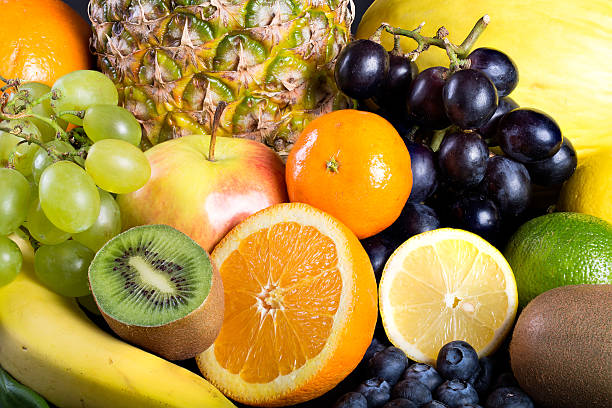 viele verschiedene exotische früchte - scyther5 stock-fotos und bilder