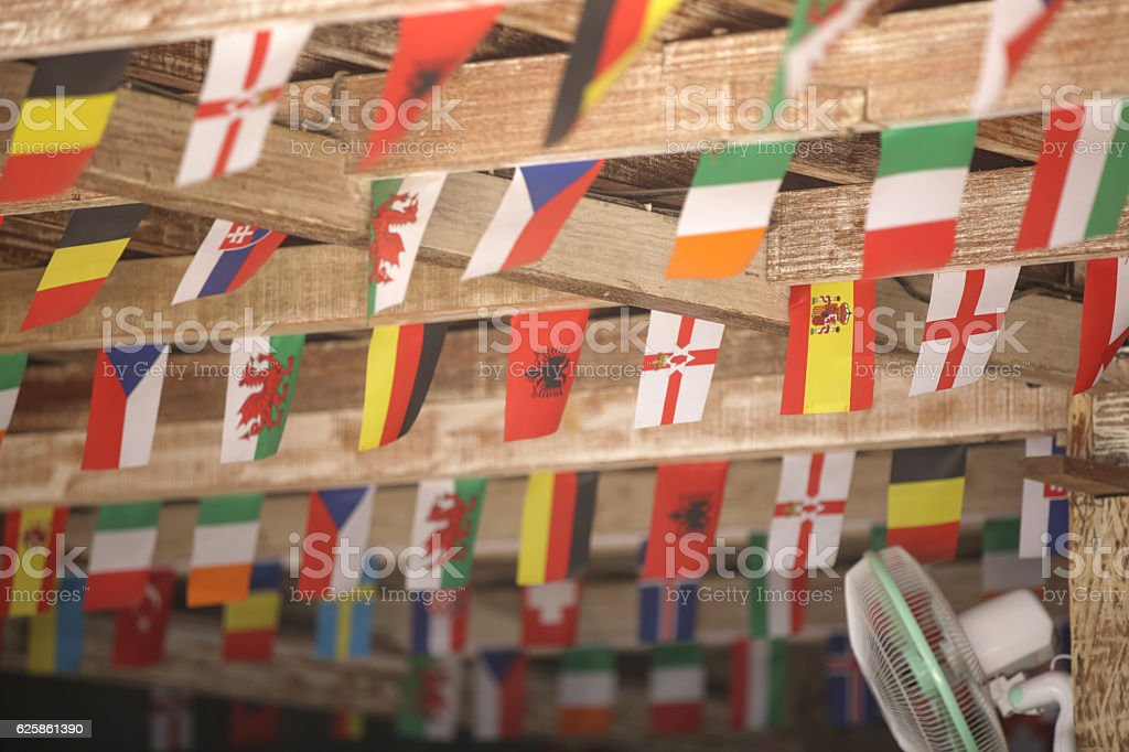 Many different flags hanging from the roof stock photo