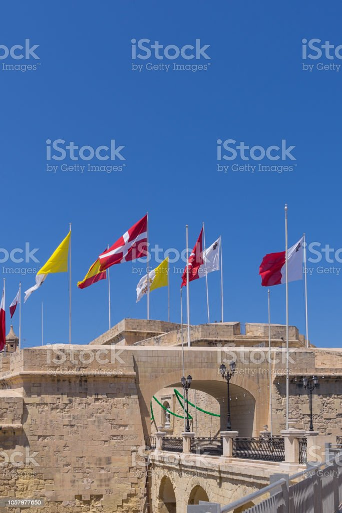 Many different flags over the city of Birgu stock photo