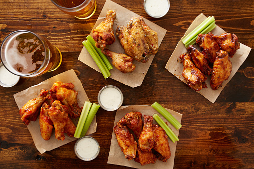 istock many different flavored buffalo chicken wings with beer 507845200