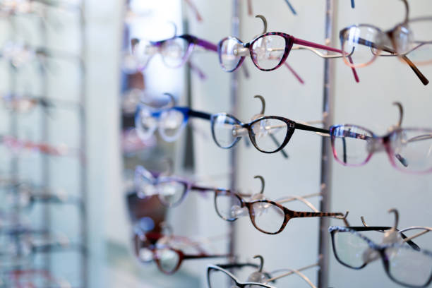 Many different glasses displayed at optician in store stock photo