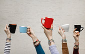 Many different hands holding coffee cups. Coffee break.
