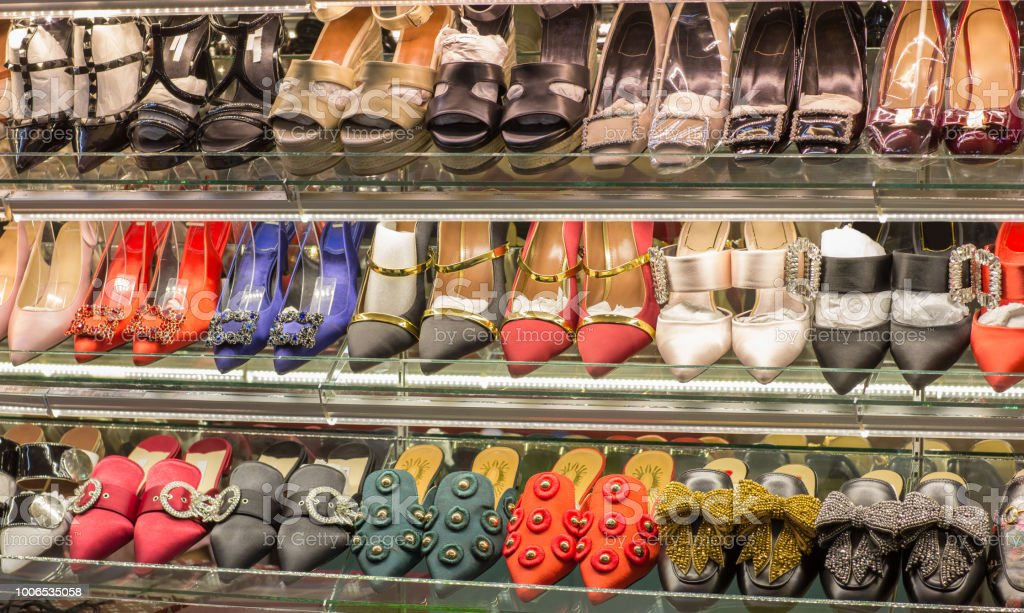 woman fashion shoes on shelves. Variety of lady shoes on shop window...