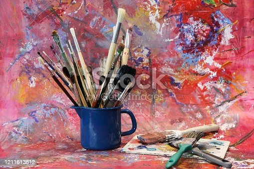 514630316 istock photo many different paint brushes in the colorful studio 1211613612