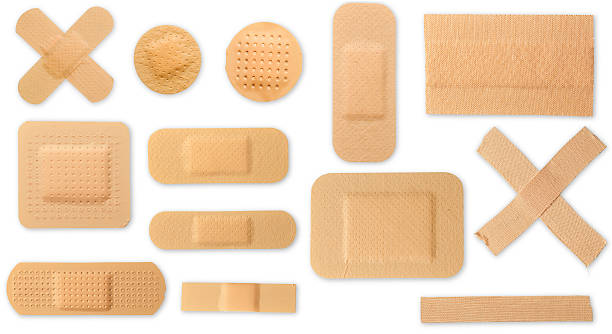 Many different plasters with clipping paths stock photo