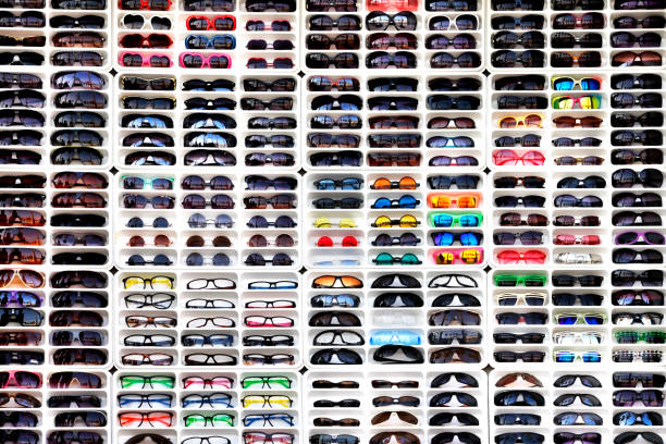 many different sunglasses in shop - sale lenses stock photos and pictures