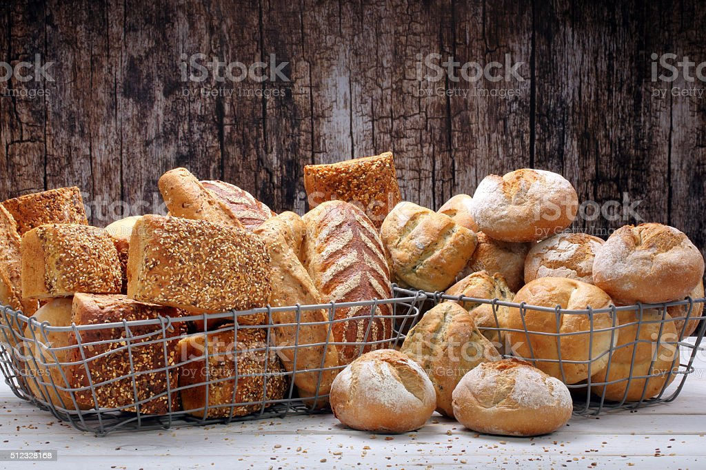 Many different types of bread in metal baskets stock photo