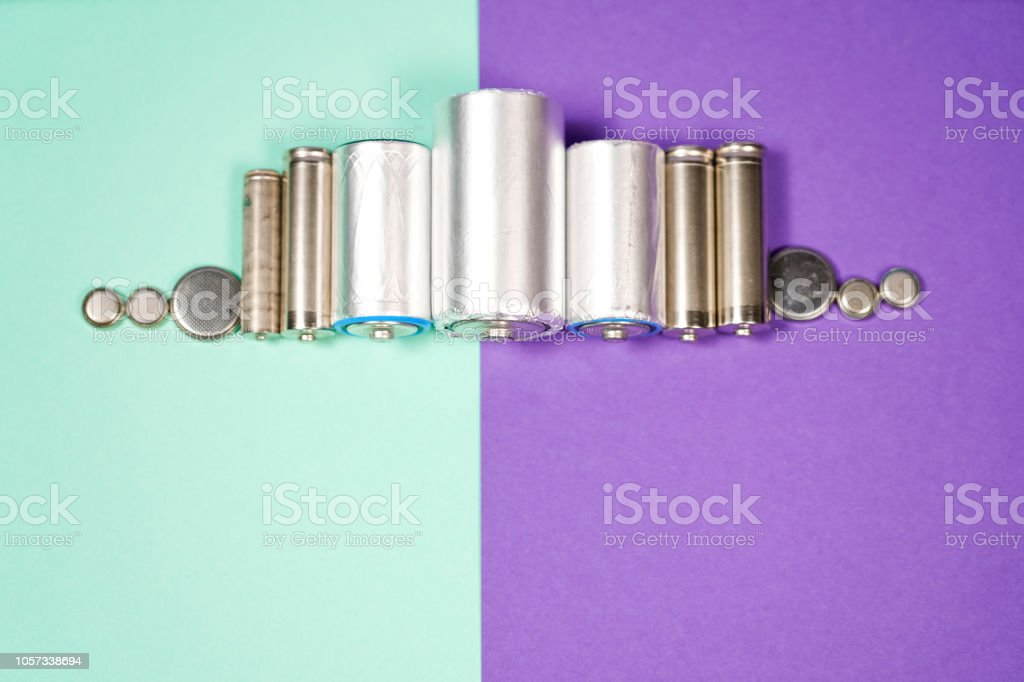 Many different types used or new battery, rechargeable accumulator, alkaline batteries on color background stock photo