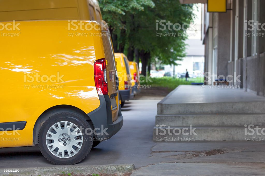 Many different yellow service cars in the parking lot stock photo
