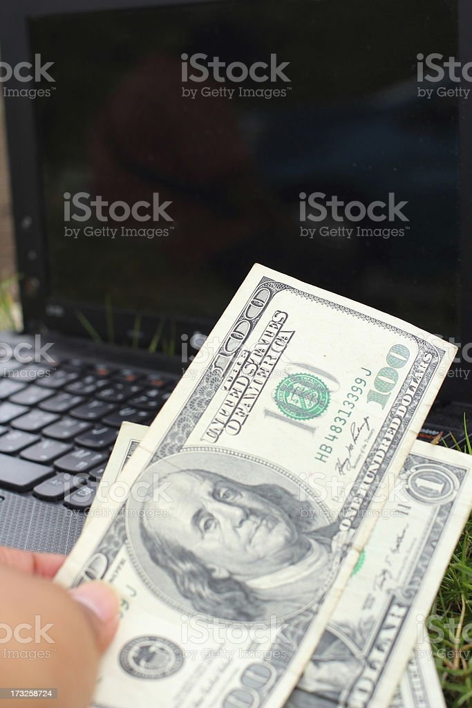 Many dollars banknotes and notebook stock photo