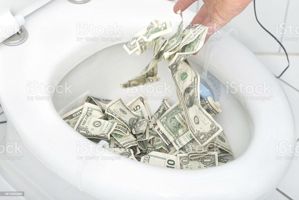 many dollars in toilet stock photo