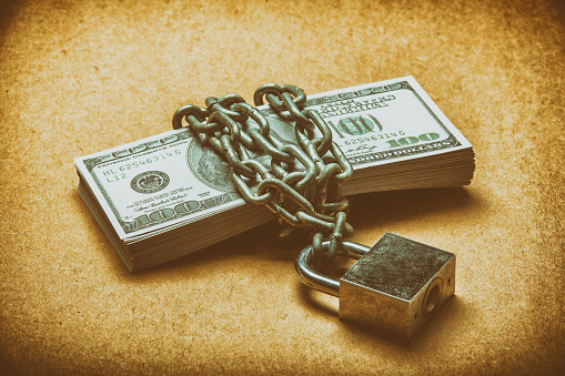 Many Dollars Is Locked With Chain Vintage Color Stock Photo - Download Image Now