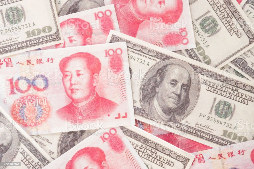 Many dollars, Money american and Chinese yuan banknotes, background. concept finance global economy. stock photo