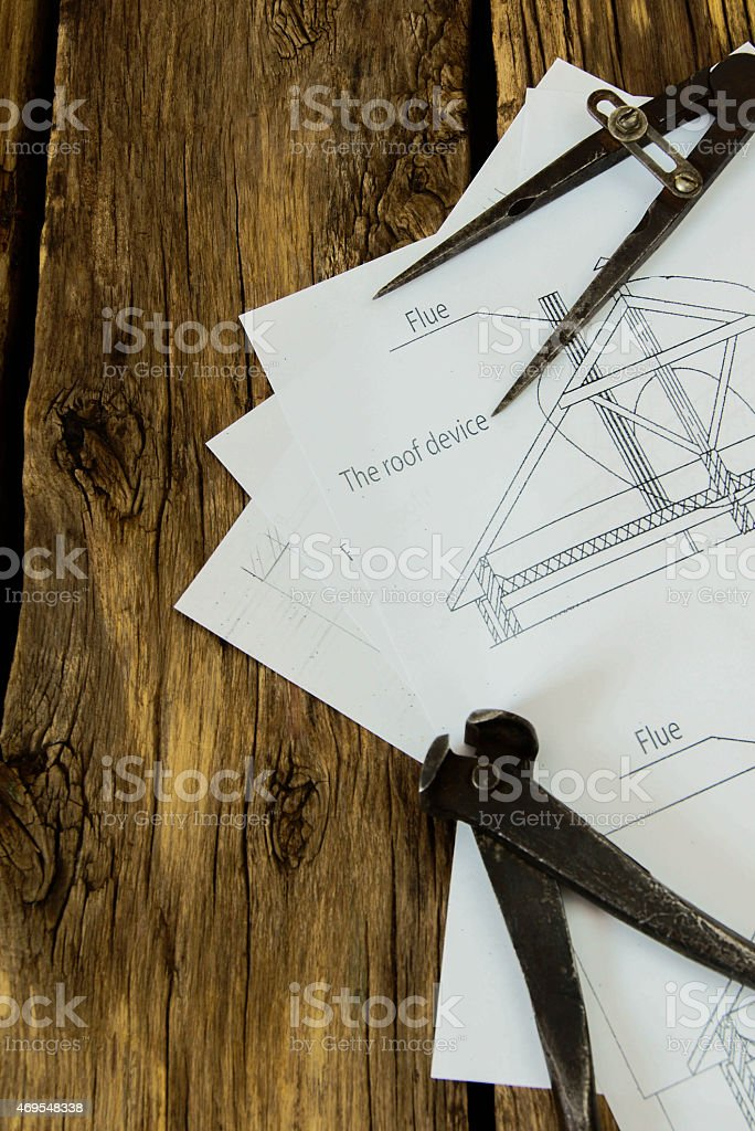 Many drawings for building and working tools on old wooden stock photo