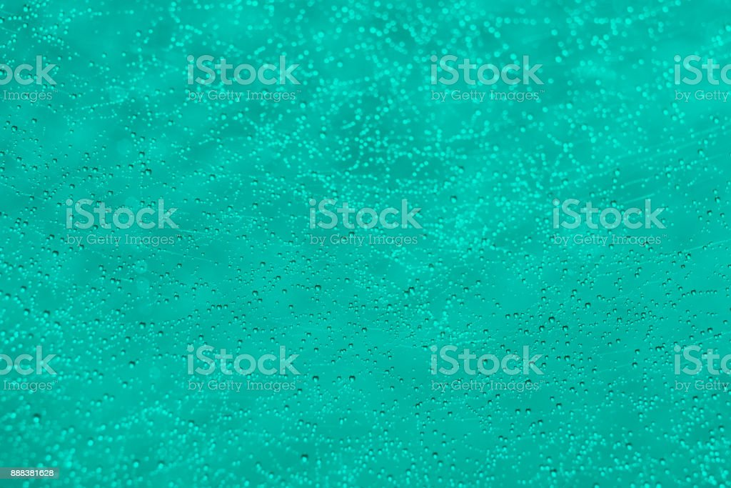 Many drops of water defocus bokeh abstract turquoise light background. stock photo