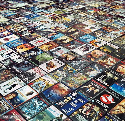Durham, England - April 15, 2011: many DVDs, mostly region 2, mostly from the British and Italian market, are arranged on the floor.  Titles in prominent position include: