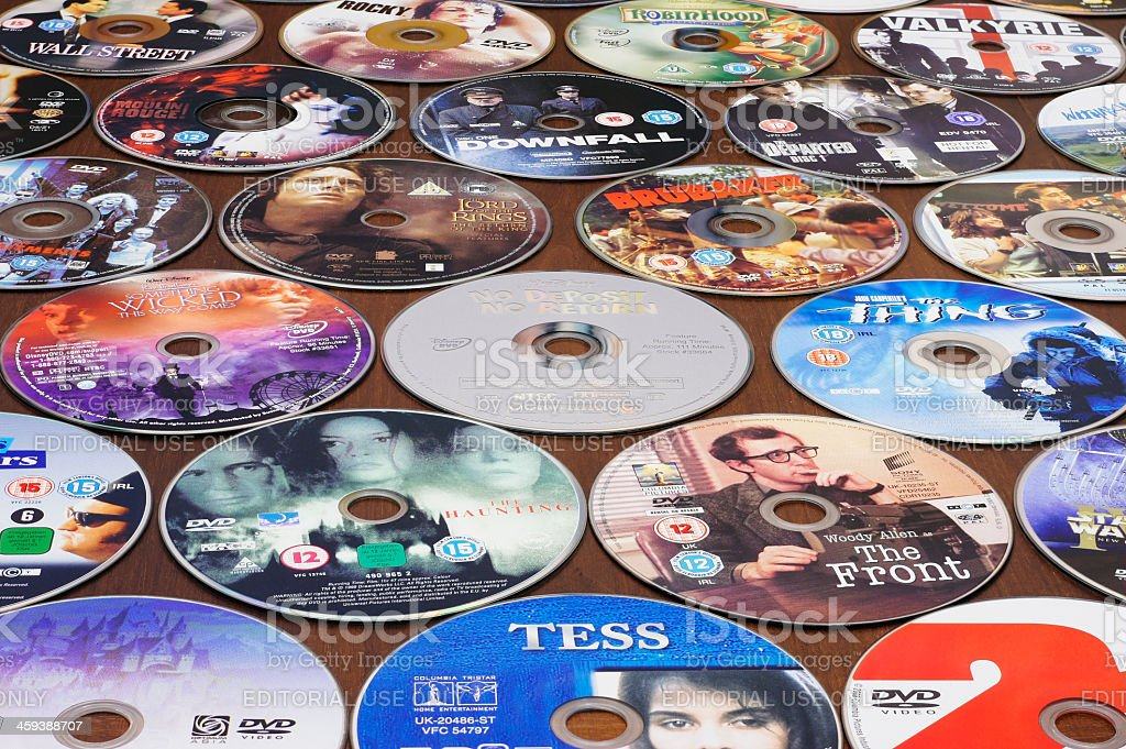 Many DVDs on a table - Background stock photo