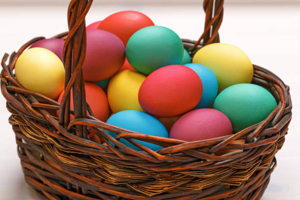 Many Easter colored eggs in the basket. Close-up Many Easter colored eggs in the basket. Close-up religious symbol stock pictures, royalty-free photos & images