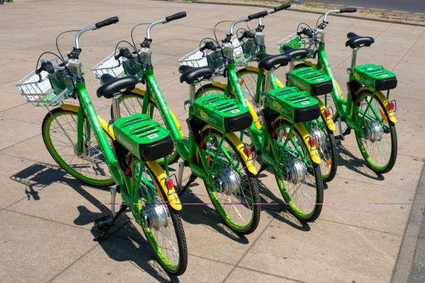 Many electric bicycles  of public bike sharing company LimeBike in  Berlin Berlin, Germany - june 2018: Many electric bicycles  of public bike sharing company LimeBike in  Berlin, Germany letter e stock pictures, royalty-free photos & images