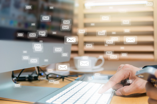istock Many e-mail over the finger pressing the computer keyboard blurred background, business technology concept 825187098