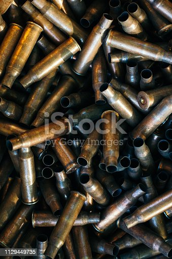 istock many empty bullet shells, pile of used rifle cartridges 7.62 mm caliber, assault rifle bullet shell, military background, top view 1129449735