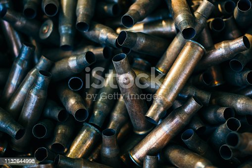 istock many empty bullet shells, pile of used rifle cartridges 7.62 mm caliber, assault rifle bullet shell, military background, top view 1132644998