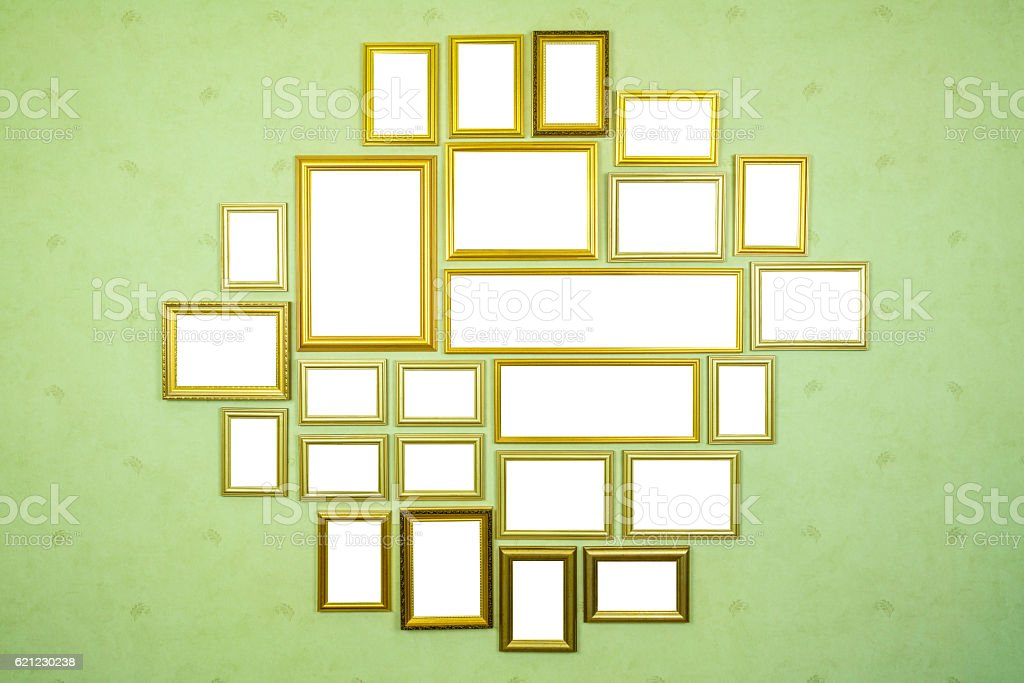 Many empty golden wooden frames with copy space on wall. stock photo