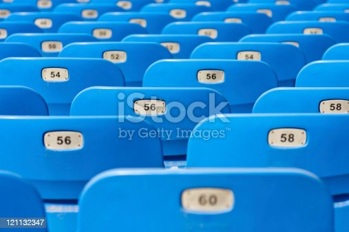 istock many empty plastic chairs with number in rows 121132347