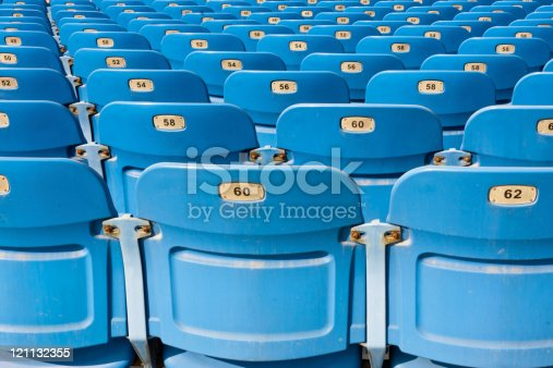 istock many empty plastic chairs with number in rows 121132355