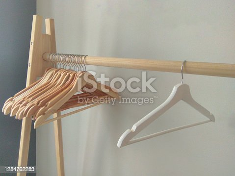 Many empty wooden clothes hangers on the rack. Store concept, sale, design, empty hangers.