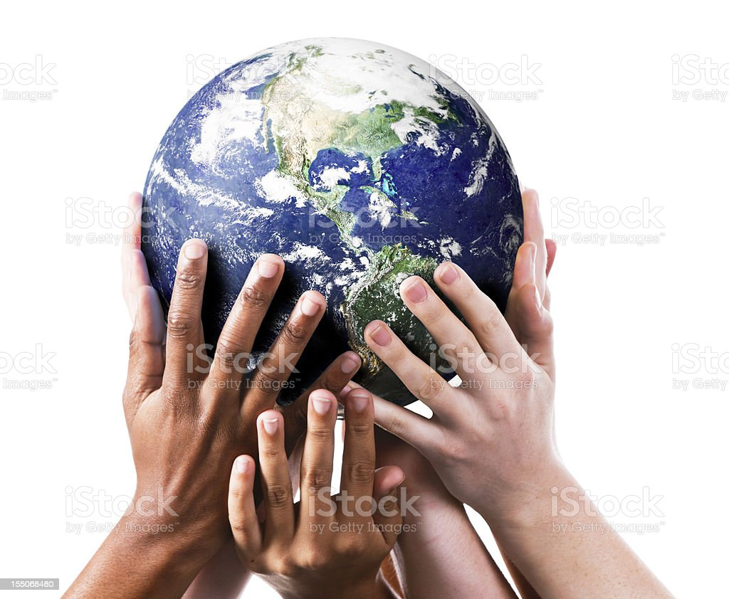 Many environmentally aware hands gently supporting the Earth. stock photo
