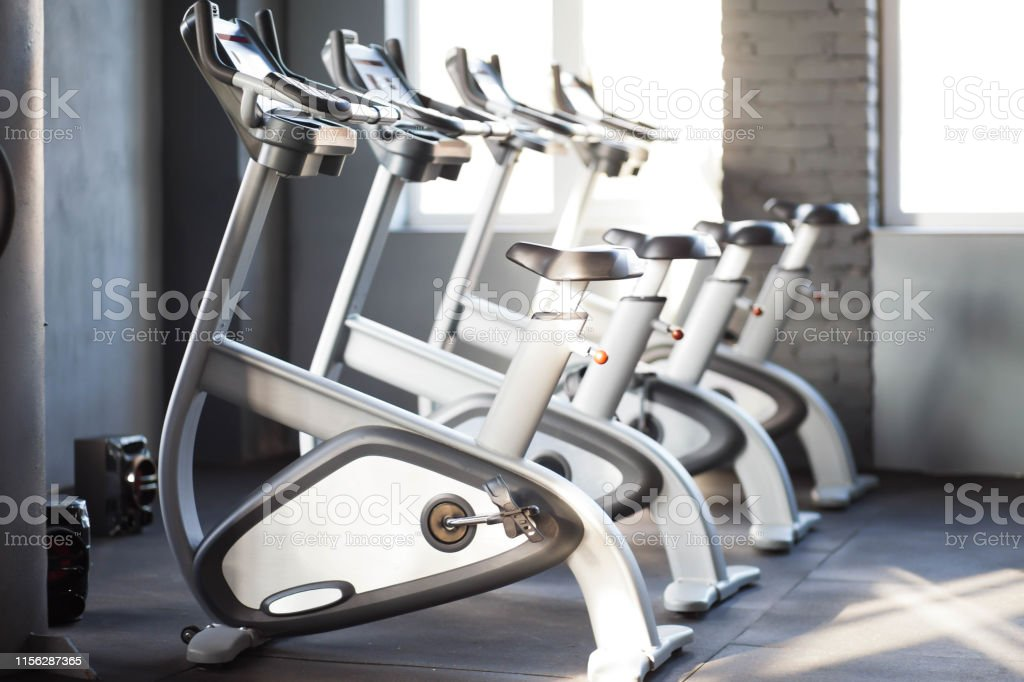 Many Exercise Bikes In The Gym Gym Equipments Interior Slimming Equipment  Stock Photo - Download Image Now - iStock