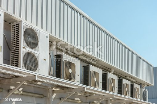 947099530 istock photo Many external air conditioning units outside a building 1091788538