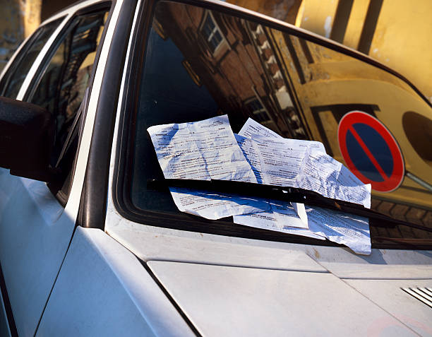 Many fines on the windscreen of a parked car stock photo