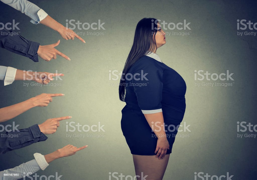 Many fingers pointing at fat woman stock photo
