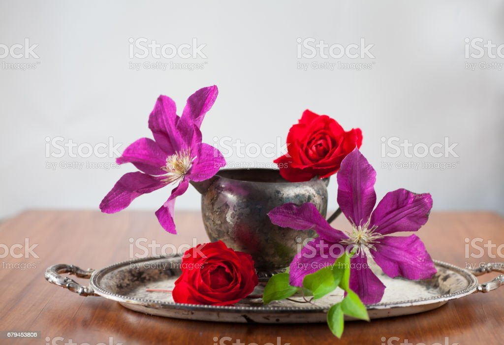 many flower buds sit in vintage metal sugar bowl on tray royalty-free stock photo