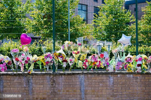 istock Many flowers in memorial at school for road accident death 1258955519
