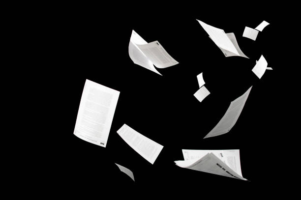 Many flying business documents isolated on black background Papers flying in air in business concept Many flying business documents isolated on black background Papers flying in air in business concept mid air stock pictures, royalty-free photos & images