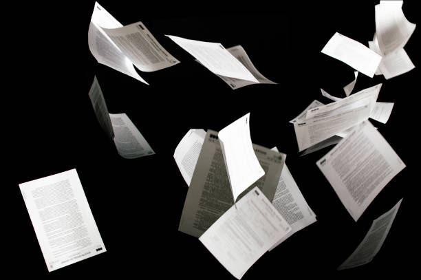 Many flying business documents isolated on black background Papers flying in air in business concept Many flying business documents isolated on black background Papers flying in air in business concept flying stock pictures, royalty-free photos & images