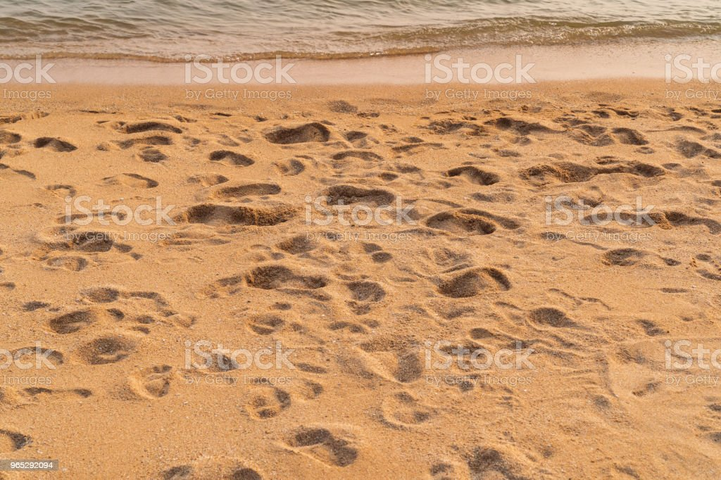 Many footprints on the beach background. zbiór zdjęć royalty-free