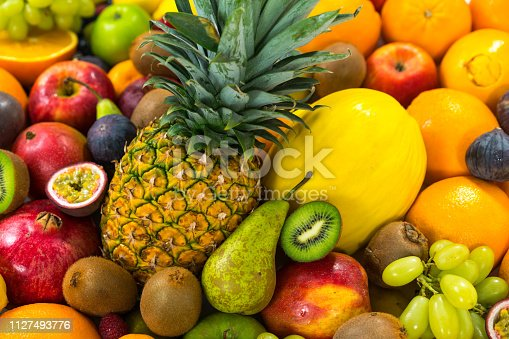 istock many fresh fruits with pineapple 1127493776