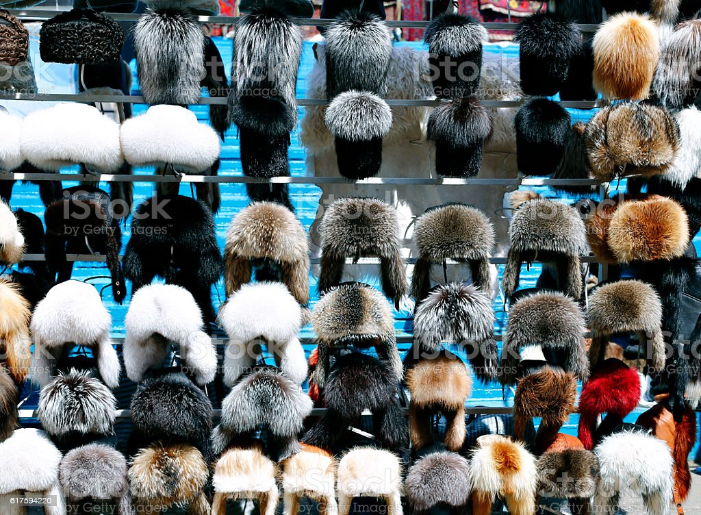 Many fur warm winter hats in Russia stock photo