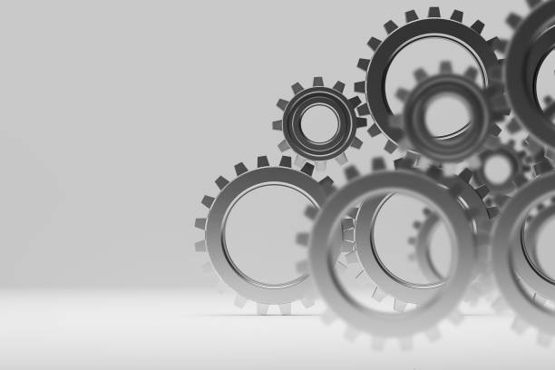 Many gears over gray background Many metal gears over gray background. Concept of cooperation and teamwork in business. 3d rendering sprocket stock pictures, royalty-free photos & images
