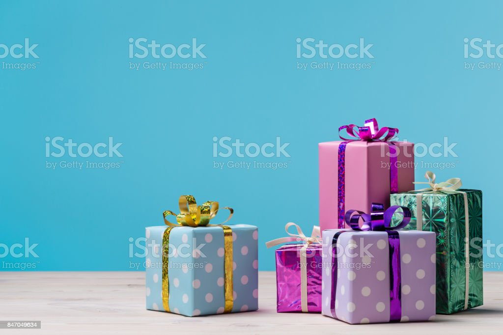 Many gift boxes on blue background. stock photo