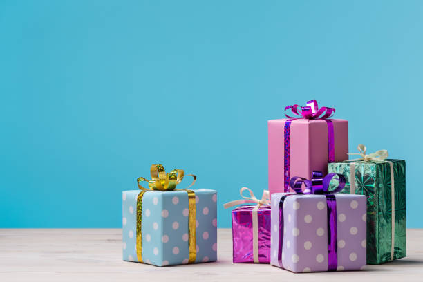 many gift boxes on blue background. - birthday gift stock photos and pictures