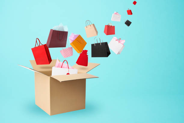 Many gift flying from a cardboard box. stock photo