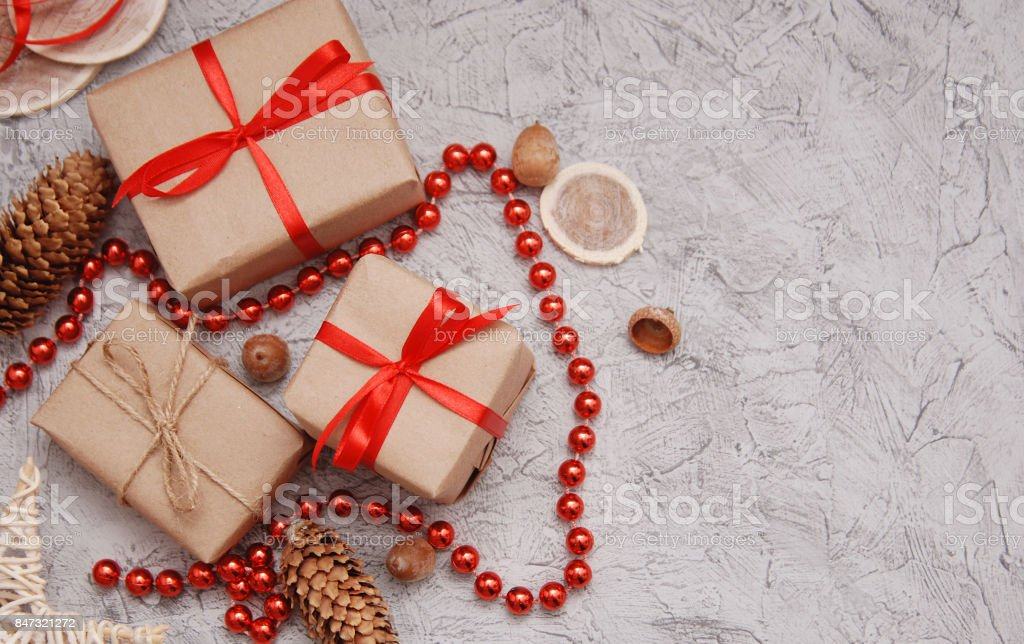 many gifts wound kraft paper, branches ate on a table stock photo