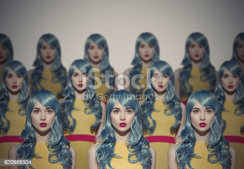istock Many Glamour Beauty Woman Clones. Identical Crowd Concept. 620968504